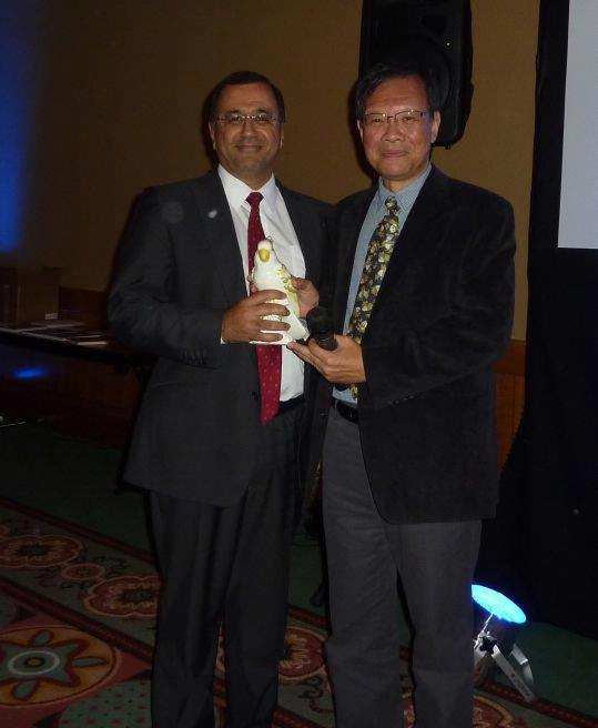 Handing over the parrot to incoming President, Dr. Anwar Padhani.